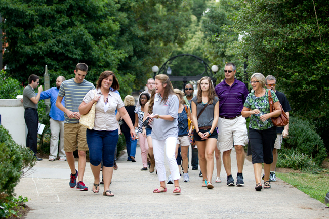 Students and parents walking together on campus